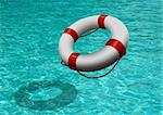 life buoy on blue water Stock Photo - Royalty-Free, Artist: razihusin                     , Code: 400-05714931