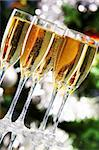 Several champagne flutes on Christmas background Stock Photo - Royalty-Free, Artist: pressmaster                   , Code: 400-05715986
