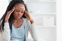 Young woman experiencing a headache Stock Photo - Royalty-Free, Artist: 4774344sean, Code: 400-05716545