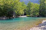 The blue waters of Voidomatis river that flows through Epirus region, Greece Stock Photo - Royalty-Free, Artist: alexandr6868                  , Code: 400-05716684