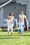 Running a family on the lawn Stock Photo - Royalty-Free, Artist: Deklofenak                    , Code: 400-05717353