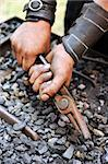 Detail of dirty hands holding pliers - blacksmith Stock Photo - Royalty-Free, Artist: brozova                       , Code: 400-05719091
