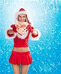 very sexy and attractive blond girl in red santa claus costume keeping a gift box over white showing gift box