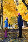 Happy family (mother with small children) walking in golden maple autumn park Stock Photo - Royalty-Free, Artist: Yuriy                         , Code: 400-05719615