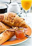 Breakfast with coffee and croissants in a basket on table Stock Photo - Royalty-Free, Artist: ilolab                        , Code: 400-05720011