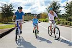 A young family of man and woman parents and one boy child, cycling together. Stock Photo - Royalty-Free, Artist: darrenbaker                   , Code: 400-05721410