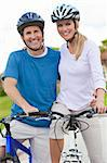 A young happy man and woman couple riding their bicycles or bikes Stock Photo - Royalty-Free, Artist: darrenbaker                   , Code: 400-05721413