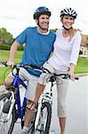 A young happy man and woman couple riding their bicycles or bikes Stock Photo - Royalty-Free, Artist: darrenbaker                   , Code: 400-05721415