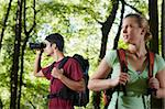 young people trekking among trees and looking at birds with binoculars. Horizontal shape, side view, waist up Stock Photo - Royalty-Free, Artist: diego_cervo                   , Code: 400-05721655