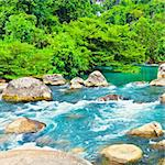 Blue water stream. Phong Nha - Ke Bang National Park. Vietnam Stock Photo - Royalty-Free, Artist: GoodOlga                      , Code: 400-05722881