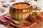 Pumpkin soup in ceramic pot, wooden spoon, flower and autumn leaf shallow DOF Stock Photo - Royalty-Free, Artist: IngridsI                      , Code: 400-05723565