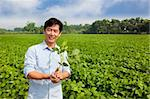 chinese farmer holding sapling and standing on his farm Stock Photo - Royalty-Free, Artist: tomwang                       , Code: 400-05724085