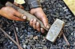 Detail of dirty hands holding hammer - blacksmith Stock Photo - Royalty-Free, Artist: brozova                       , Code: 400-05726037