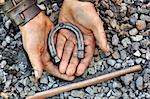 Detail of dirty hands holding horseshoe - blacksmith Stock Photo - Royalty-Free, Artist: brozova                       , Code: 400-05726038