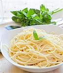 fresh spaghetti with basil leaves on white dish Stock Photo - Royalty-Free, Artist: trexec                        , Code: 400-05727867