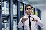 young handsome business man  engeneer in datacenter server room Stock Photo - Royalty-Free, Artist: dotshock                      , Code: 400-05728783