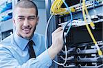 young handsome business man  engeneer in datacenter server room Stock Photo - Royalty-Free, Artist: dotshock                      , Code: 400-05728907