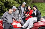 Gang Of Youths Sitting On Cars Stock Photo - Royalty-Free, Artist: MonkeyBusinessImages          , Code: 400-05729508