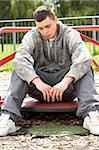 Young Man Sitting In Playground Stock Photo - Royalty-Free, Artist: MonkeyBusinessImages          , Code: 400-05729522