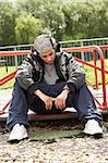 Young Man Sitting In Playground Stock Photo - Royalty-Free, Artist: MonkeyBusinessImages          , Code: 400-05729524