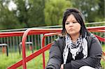 Young Woman Sitting In Playground Stock Photo - Royalty-Free, Artist: MonkeyBusinessImages          , Code: 400-05729531