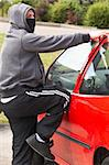 Young Man Breaking Into Car Stock Photo - Royalty-Free, Artist: MonkeyBusinessImages          , Code: 400-05729547