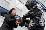Man Mugging Woman In Street Stock Photo - Royalty-Free, Artist: MonkeyBusinessImages          , Code: 400-05729559