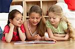 Three Young Girls Reading Book at Home Stock Photo - Royalty-Free, Artist: MonkeyBusinessImages          , Code: 400-05729737
