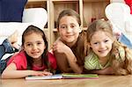 Three Young Girls Reading Book at Home Stock Photo - Royalty-Free, Artist: MonkeyBusinessImages          , Code: 400-05729738