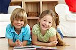 Two Young Children Reading Book at Home Stock Photo - Royalty-Free, Artist: MonkeyBusinessImages          , Code: 400-05729743