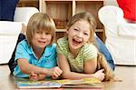 Two Young Children Reading Book at Home Stock Photo - Royalty-Free, Artist: MonkeyBusinessImages          , Code: 400-05729744