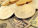 Close-up macro shot of $50 dollar, $100 dollar $25 Gold and $1 Silver U.S. Bullion Coins. Shot on Canon.