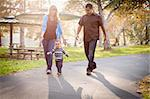 Happy Young Mixed Race Ethnic Family Walking In The Park. Stock Photo - Royalty-Free, Artist: Feverpitched                  , Code: 400-05732073