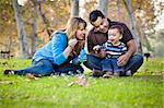 Happy Young Mixed Race Ethnic Family Playing with Bubbles In The Park. Stock Photo - Royalty-Free, Artist: Feverpitched                  , Code: 400-05732077