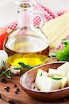 Feta cheese sllices with olive oil and rosemary Stock Photo - Royalty-Free, Artist: mythja                        , Code: 400-05732414