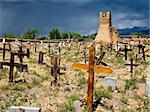 The old cemetery, surrounding the original church of San Geronimo, is filled with old graves. The graveyard is in sunlight while the dark sky looming in the background is a precursor to a thunderstorm. Stock Photo - Royalty-Free, Artist: searagen                      , Code: 400-05732910