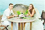 Bride and groom at wedding table near the sea Stock Photo - Royalty-Free, Artist: GoodOlga                      , Code: 400-05733439