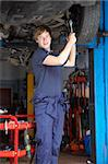 Mechanic working on car Stock Photo - Royalty-Free, Artist: MonkeyBusinessImages          , Code: 400-05735183