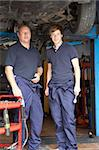 Mechanic and apprentice working on car Stock Photo - Royalty-Free, Artist: MonkeyBusinessImages          , Code: 400-05735213