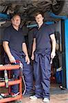 Mechanic and apprentice working on car Stock Photo - Royalty-Free, Artist: MonkeyBusinessImages          , Code: 400-05735216