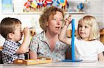 Adult Helping Two Young Children at Montessori/Pre-School Stock Photo - Royalty-Free, Artist: MonkeyBusinessImages          , Code: 400-05735262