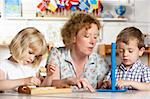 Adult Helping Two Young Children at Montessori/Pre-School Stock Photo - Royalty-Free, Artist: MonkeyBusinessImages          , Code: 400-05735264