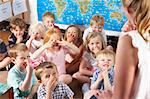 Montessori/Pre-School Class Listening to Teacher on Carpet Stock Photo - Royalty-Free, Artist: MonkeyBusinessImages          , Code: 400-05735279