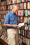 Male customer in bookshop Stock Photo - Royalty-Free, Artist: MonkeyBusinessImages          , Code: 400-05735313