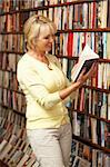 Female customer in bookshop Stock Photo - Royalty-Free, Artist: MonkeyBusinessImages          , Code: 400-05735315