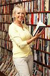 Female customer in bookshop Stock Photo - Royalty-Free, Artist: MonkeyBusinessImages          , Code: 400-05735316