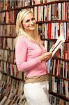 Female customer in bookshop Stock Photo - Royalty-Free, Artist: MonkeyBusinessImages          , Code: 400-05735318