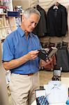 Male customer in clothing store Stock Photo - Royalty-Free, Artist: MonkeyBusinessImages          , Code: 400-05735347