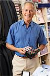 Male customer in clothing store Stock Photo - Royalty-Free, Artist: MonkeyBusinessImages          , Code: 400-05735349