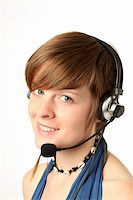 rainerplendl - young woman with a headset smilling Stock Photo - Royalty-Freenull, Code: 400-05735739